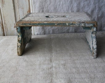 Shabby and primitive foot stool - European