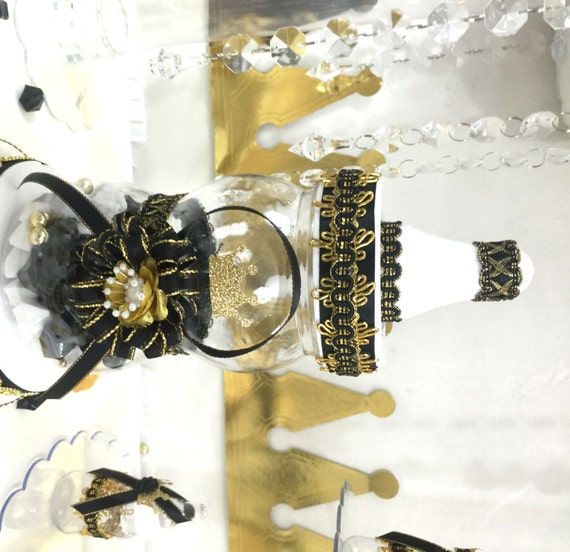 Black gold bottle centerpiece for prince by