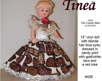 Tinea', Christmas or Valentine's Day musical Caucasian doll dresses in chocolate print