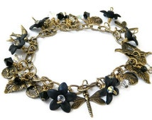 OOAK Secret Garden Charm Bracelet, in Antique Gold, with Swarovski Crystal Beads in Jet Black and Crystal AB, Lucite Flowers and Gold Charms