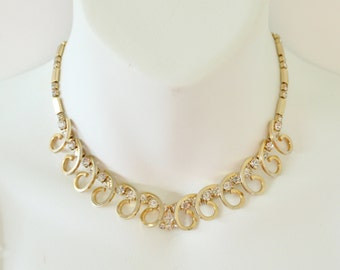 Vintage 1956 Signed Sarah Coventry Celestial Fire Gold Tone Prong Set Clear Rhinestone Swirl Mid Century Hollywood Regency Necklace