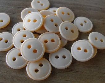 24 Peach Lifted Rim Round Buttons Size 7/16""