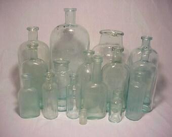 c1860-1870s Group of 16 Cork Top Mixed Aqua Glass Medicine & Food Bottles Great for Wedding Decor or Civil War Props