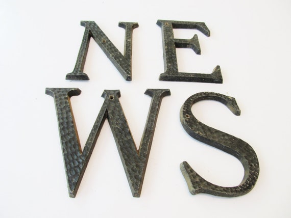 set of 4 black vintage weathervane letters by With hammered letters into metal