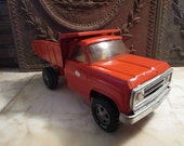 Vintage orange, 1960s era, 'Tonka' dump truck!