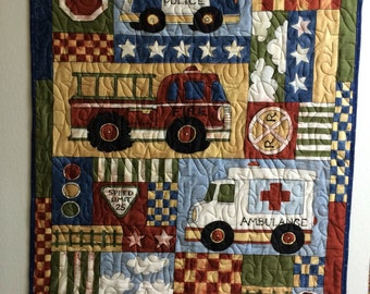 Baby quilt with fire trucks  34 x 42.