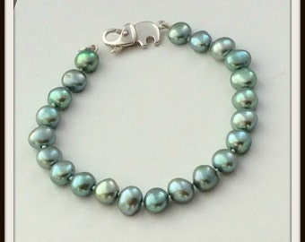 OOAK Mint green freshwater pearls buttons elephant sterling silver clasp . Classic threading on silk.