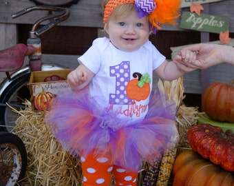 Baby Girl 1st Birthday Pumpkin Tutu Outfit - This Pumpkin is 1 - tutu, bodysuit, leg warmers, Over The Top bow in orange, green and purple