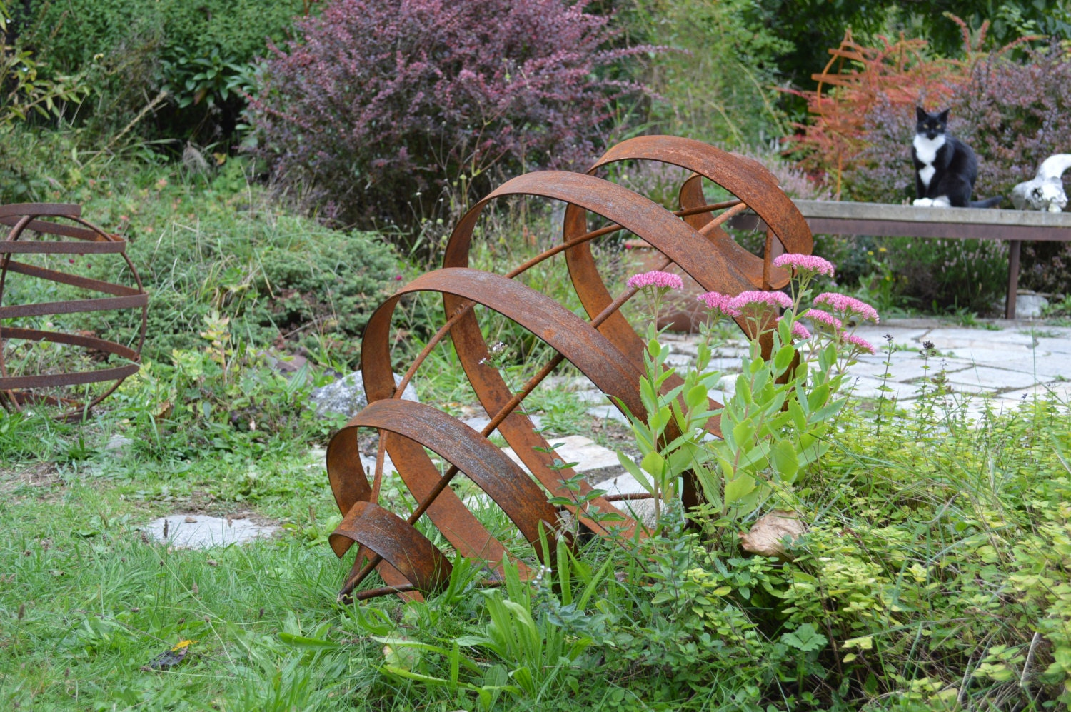 For mary pod garden sculpture rusted metal art seed pod for Backyard art