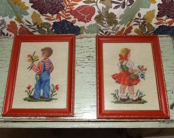 "Two darling vintage needlepoint pictures of children with flowers, red frames with gold detailing, ready to hang, 9 1/4"" x 7 3/16"""