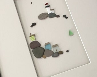12 by 16 sea side art made with pebbles sea glass and sea pottery by sharon nowlan