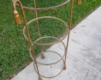 GOLDEN OLDIE / Hollywood Regency Italian Gilt Rope and Tassel 4 Glass Shelf Etagere / Elegant
