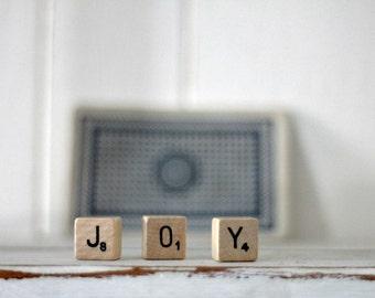 vintage wood block word JOY