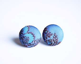 Fabric covered button earrings in lavender blue with a bronse pattern, silk fabric