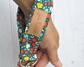 Teal key fob. Teal, orange, aqua and yellow floral and butterfly wrist strap key chain. Fabric wristlet key chain.