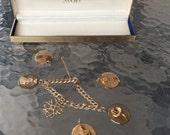 Vintage chunky charm bracelet 10K jeweled gf Avon Calling President Award 6 Charms gold fill plate