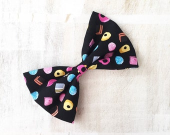Black with multi color liquorice all sorts candy print large hair bow