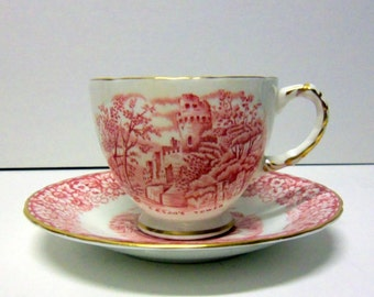 Red and White Historical Brita cup and saucer