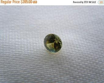 SEPTEMBER SALLE Loose Montana Sapphire Tri Colored Orange/Blue/Green .45 carat Round