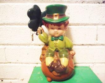 Weird leprechaun bank irish humor St. Patrick's Day pot of gold retro green and brown