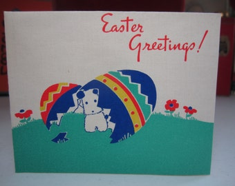 Adorable unused 1940's norcross easter card little terrier puppy popping out of a colorful easter egg