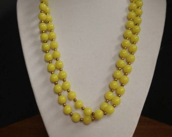 PRICE REDUCED Vintage long yellow beaded necklace.