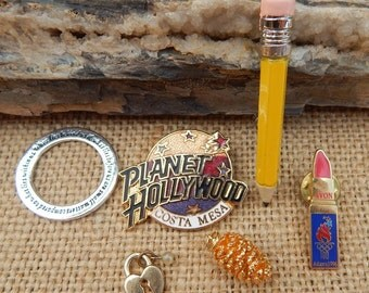 Gold Dipped Pine Cone  ~  Planet Hollywood Pin  ~  Avon 1996 Olympic Collectible Lipstick Pin  ~  Pencil Brooch  ~  Lot of Jewelry Pieces