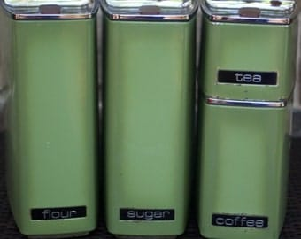 Vintage set of 4 tin canisters