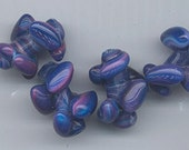 Four awesome vintage Japanese lampwork glass beads -- gorgeous swirled shape in dark purple blue with accented  blue, pink, purple swirls