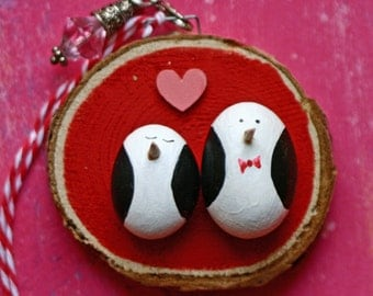 Fat penguins, painted rocks on wood slice, Christmas ornament, winter, found art, pebble, round, black and red, white, love, couple