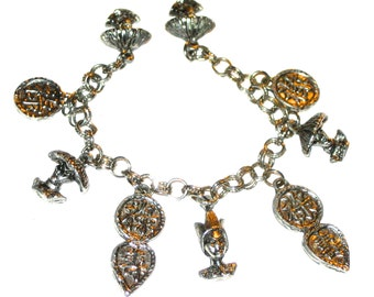 Vintage 50s era silver metal charm bracelet Asian style designs faces