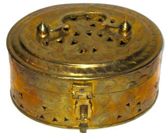 Vintage brass box with top handle pierced openings cricket box