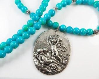Blue green cherub necklace