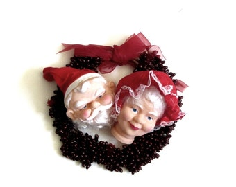 Vinyl Santa and Mrs Claus Doll Heads Red Cloth Hat Curly Nylon Hair Holiday Doll Parts NOS Christmas Home Decor