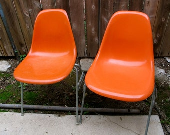 Pair of Orange EAMES Herman Miller FIBERGLASS and Resin Side Chairs