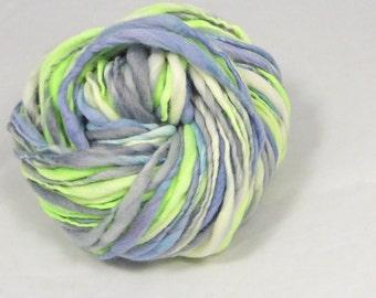 Spring Storm thick and thin yarn. Hand spun, hand dyed slub. Pure Australian 21 micron merino wool.