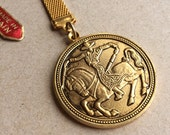 vintage nos double-sided medallion key chain with raised relief of matador on one side and caballero on the other--made in Spain
