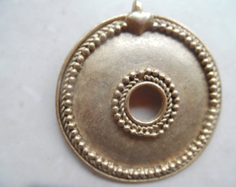 vintage round brass handcrafted   pendant ...excellent condition..