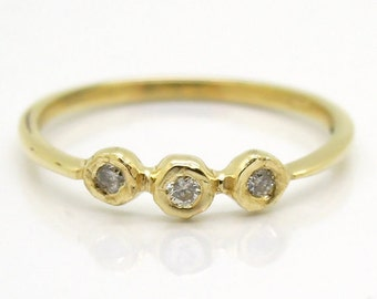 White diamond engagement ring, in a shiny & polished yellow gold band