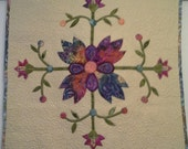 Flower Wallhanging. Batik fabric ,Sulky blendables. Custom Quilting, blue fantasy backing,