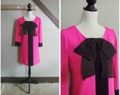 RESERVED/ The Buzz 1960s Long Sleeve Hot Pink and Black Mod Dress with Over Sized Bow Detail