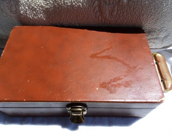 Wooden box with Bakelite handle/was mobile liquor cabinet/room for two bottles/shot glasses enclosed