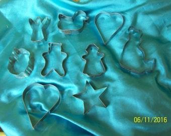 9 vintage metal cookie cutters