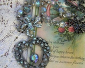 Assemblage Necklace with Pale Blue Aurora Borealis Vintage Rhinestone Brooch