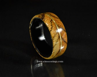 Tiger wood ring with Irish bog Oak and brass guitar string inlay