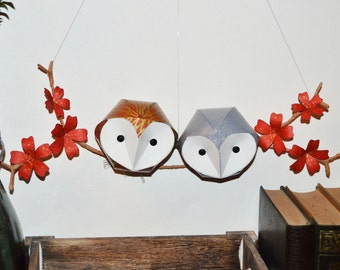 owl sculptures on a red floral branch, woodland wall art