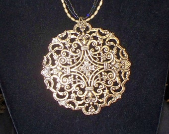 Beaded Necklace with Brass Filigree Medallion