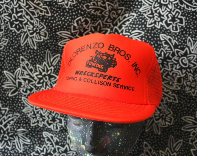 Featured listing image: Vintage Trucker Snapback Orange Baseball Cap. Retro Mesh Back Towing And Collision 80s Baseball Cap.Hipster 80s Orange Mesh Trucker Cap