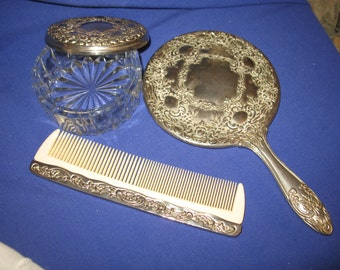 Set of mirror, comb and small jewelry chest.