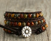Earth tone beaded bracelet. Natural triple wrap leather bracelet. Bohemian chic wrap